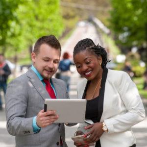 Man ans women sharing tablet