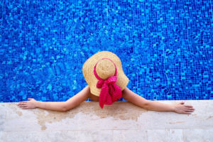 person sitting in pool